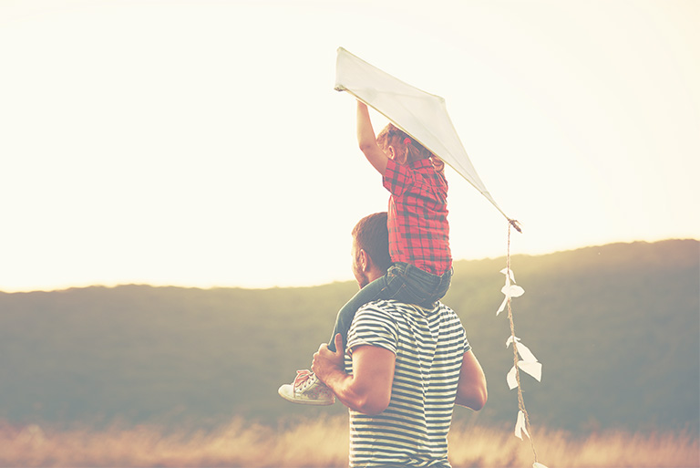 father son in field kite