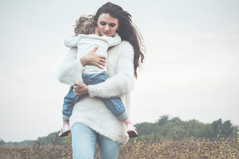 woman hugging son
